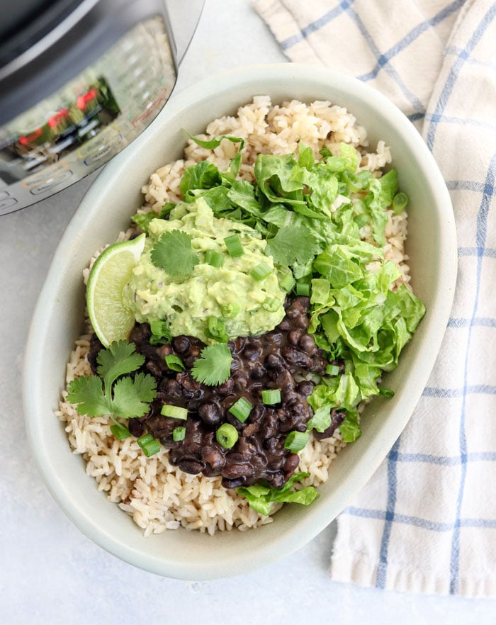 These CHIPOTLE BURRITO BOWLS are so easy in the Instant Pot! The black beans & brown rice cook from scratch (at the same time!) for a healthy meal. Perfect for a vegan or vegetarian dinner. #instantpot #vegan