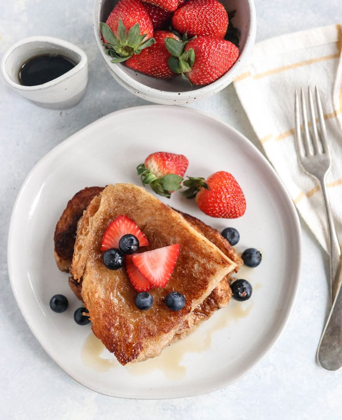 This easy VEGAN FRENCH TOAST is egg-free and dairy-free, with a crisp outside and tender inside. It's the best recipe I've tried! Gluten-free tips included, plus extra egg substitute options like arrowroot starch, chia, and flax eggs. #vegan #breakfast