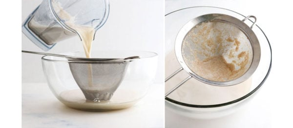 straining oat milk in mesh strainer