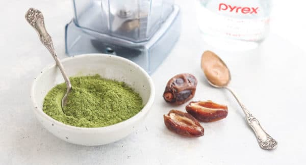 matcha latte ingredients on a white counter