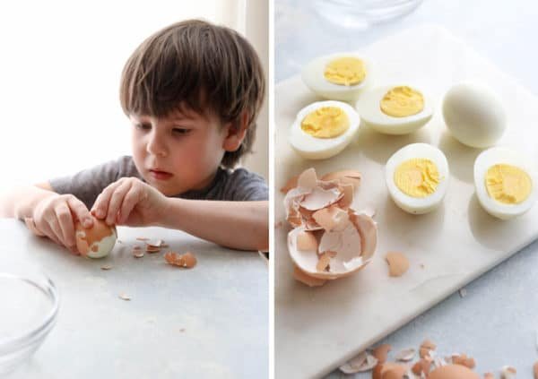 child helping to peel hard boiled eggs