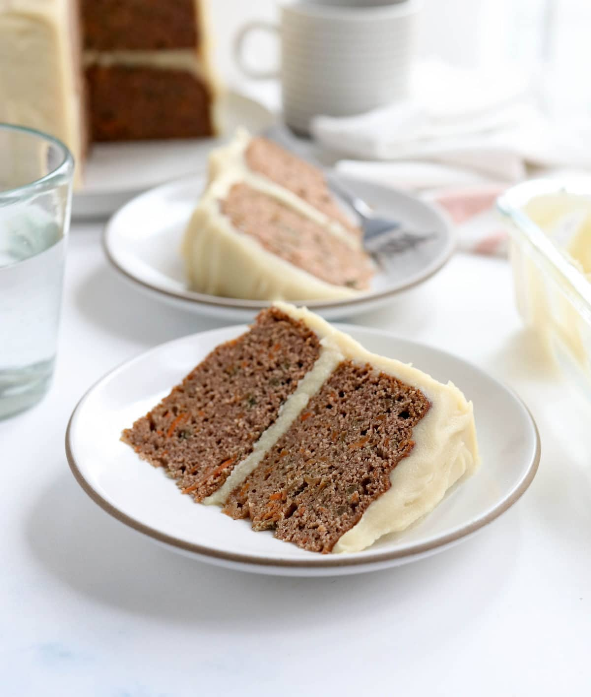 carrot cake slice on a plate with frosting