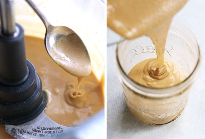 smooth almond butter going into jar