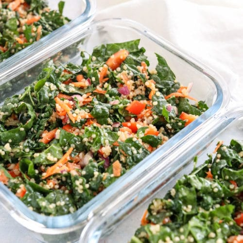kale quinoa salad in meal prep containers