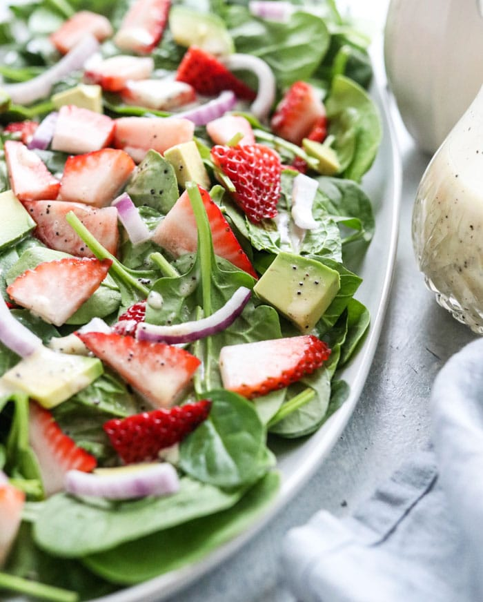 strawberries, avocado & red onion spinach salad