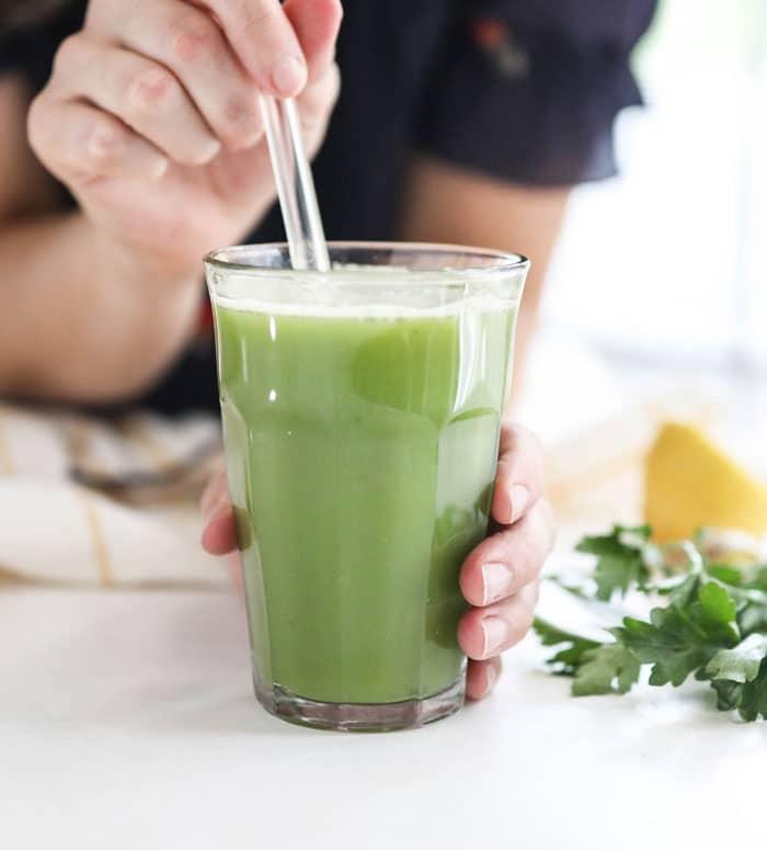 detox juice with glass straw