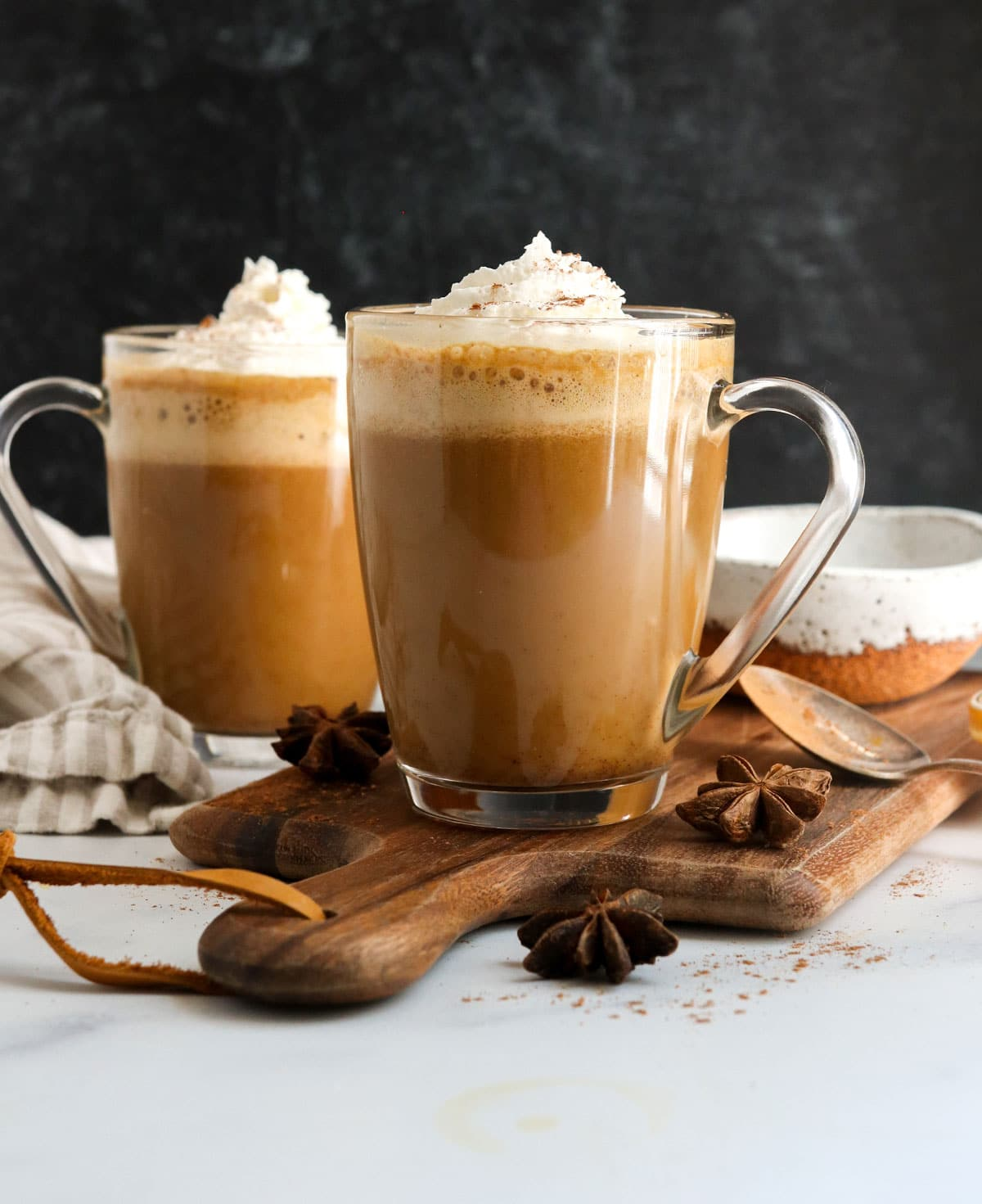 pumpkin spice latte in 2 glasses with black background