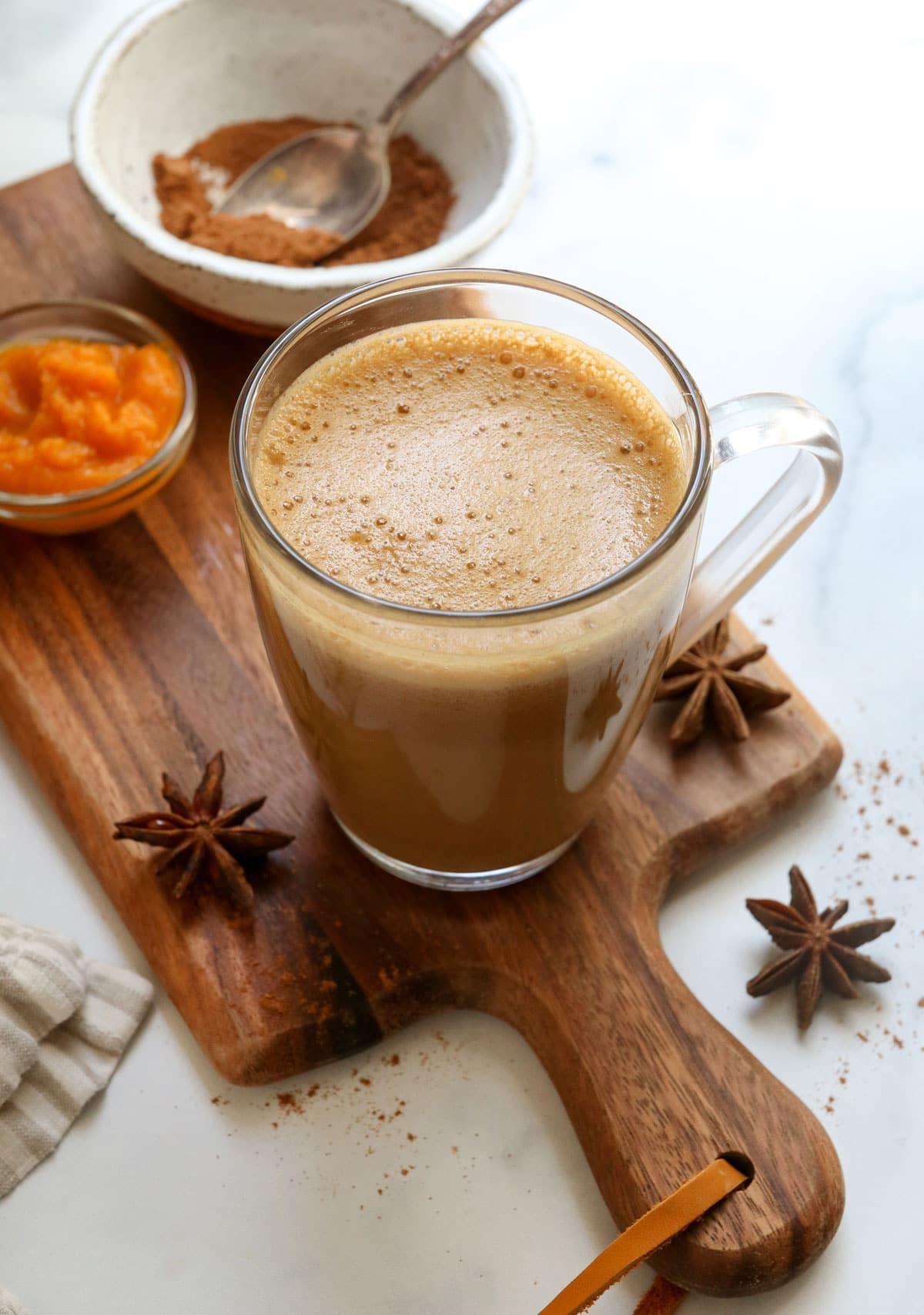 pumpkin spice latte with foam on top at an angle