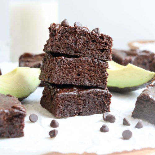 avocado brownies stacked on cutting board