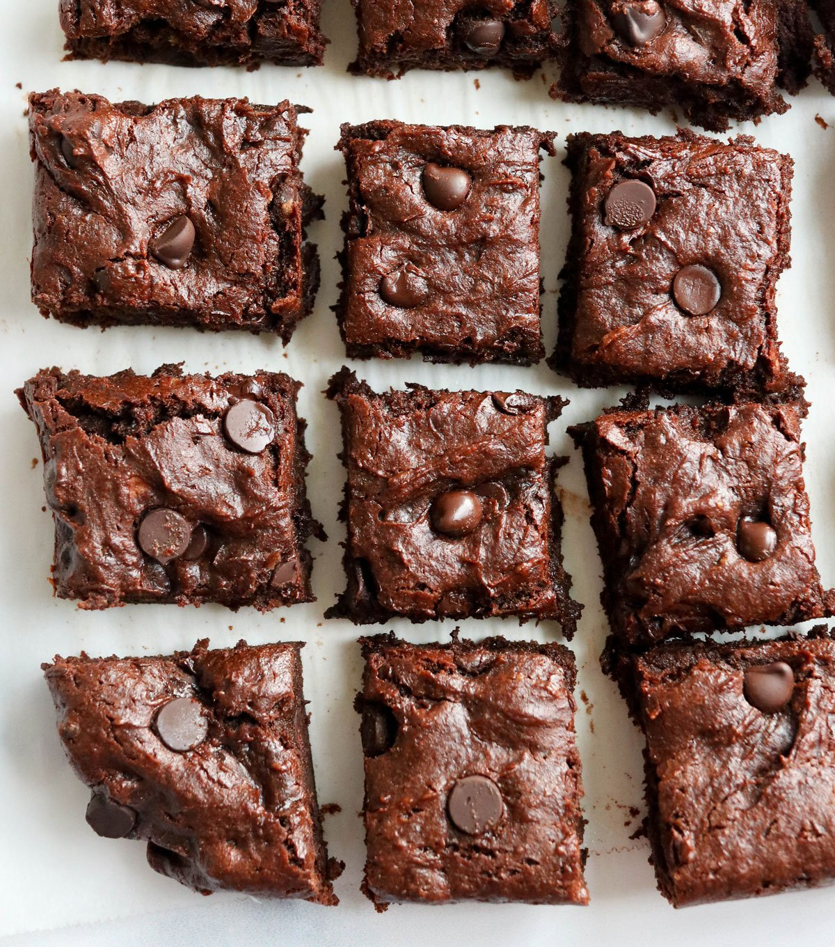sliced sweet potato brownies on white surface