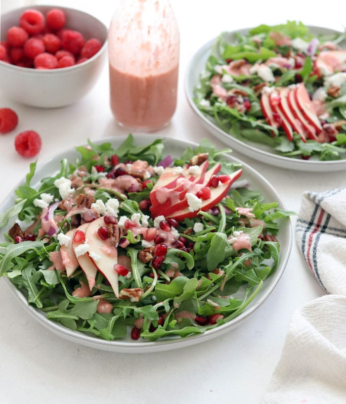 arugula salad with fruit on top