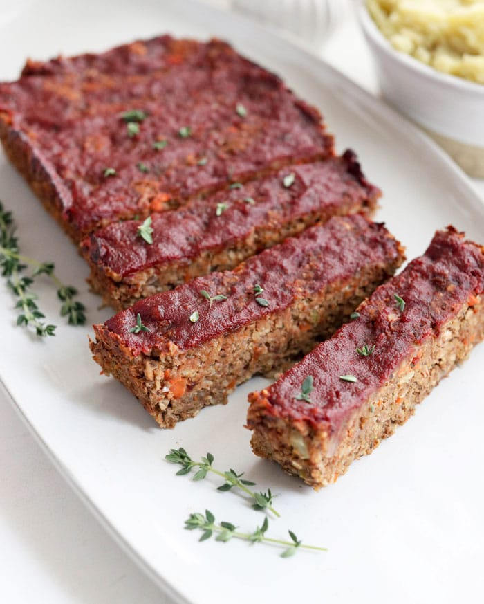 vegan meatloaf slices on a white plate