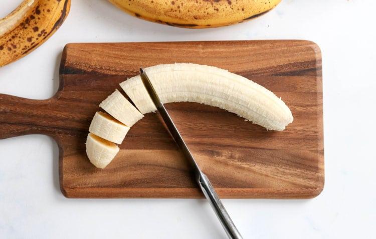 sliced banana on cutting board