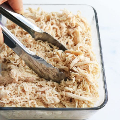 shredded chicken with tongs