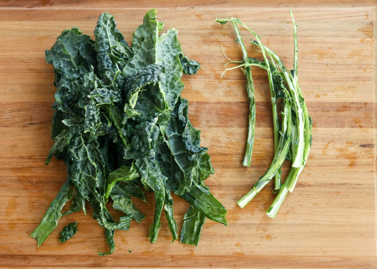 lacinato kale on cutting board with stems removed
