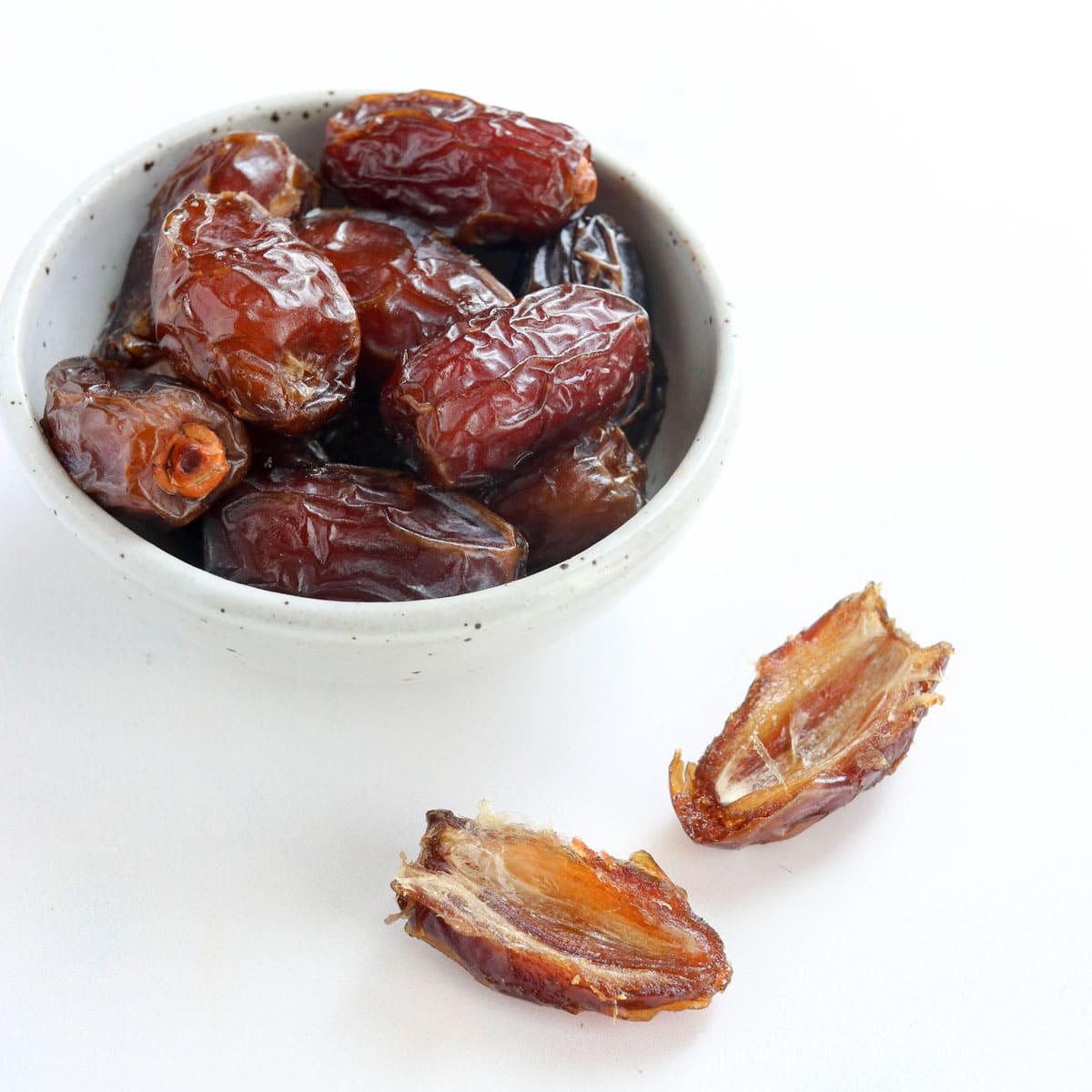 medool dates in white bowl