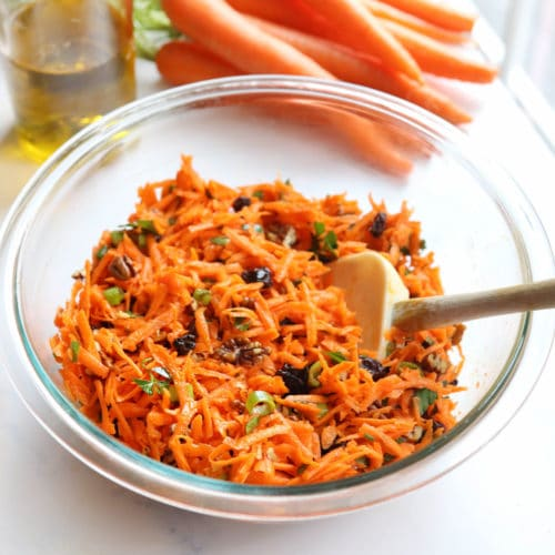carrot salad in glass bowl with spatula