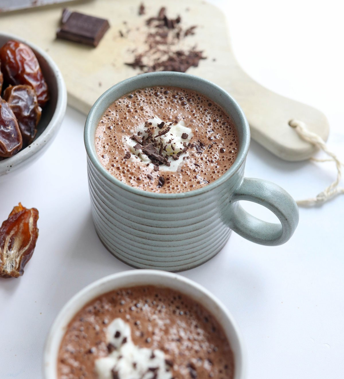 hot chocolate with coconut whipped cream and chocolate shavings