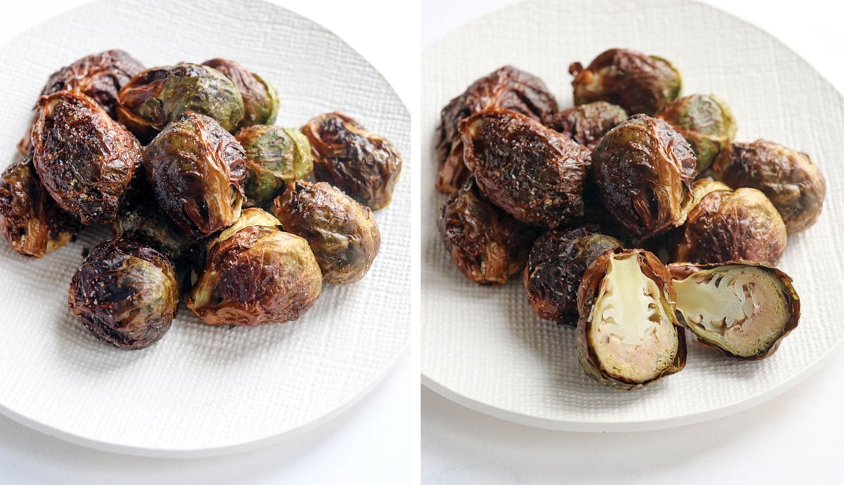 brussels sprouts on a white plate with one cut in half