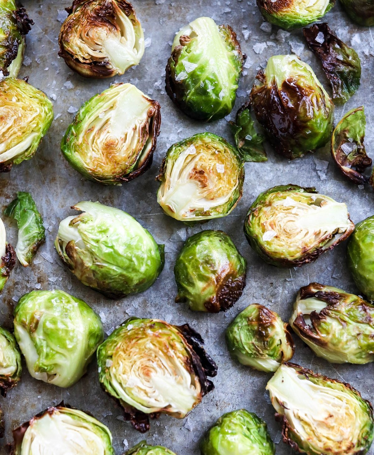 air fryer brussels sprouts on a pan with salt