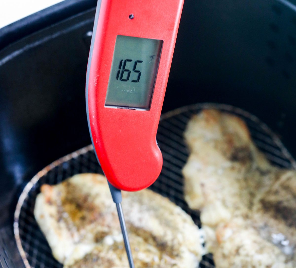 thermometer in chicken showing 165