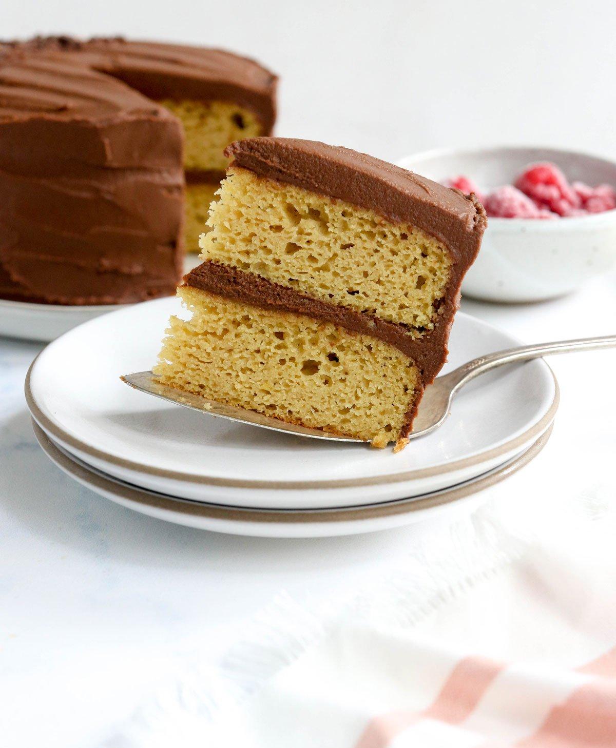 sliced of almond flour cake balanced on a cake server