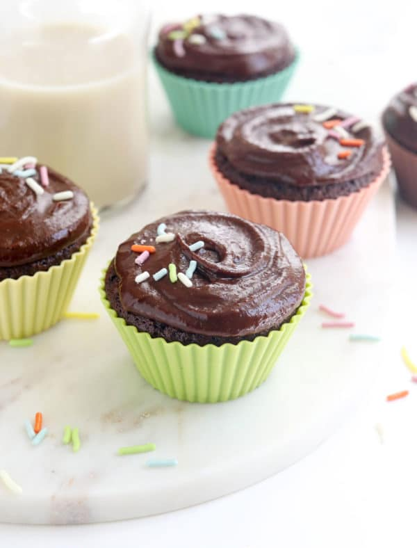 chocolate almond flour cupcakes with frosting and sprinkles