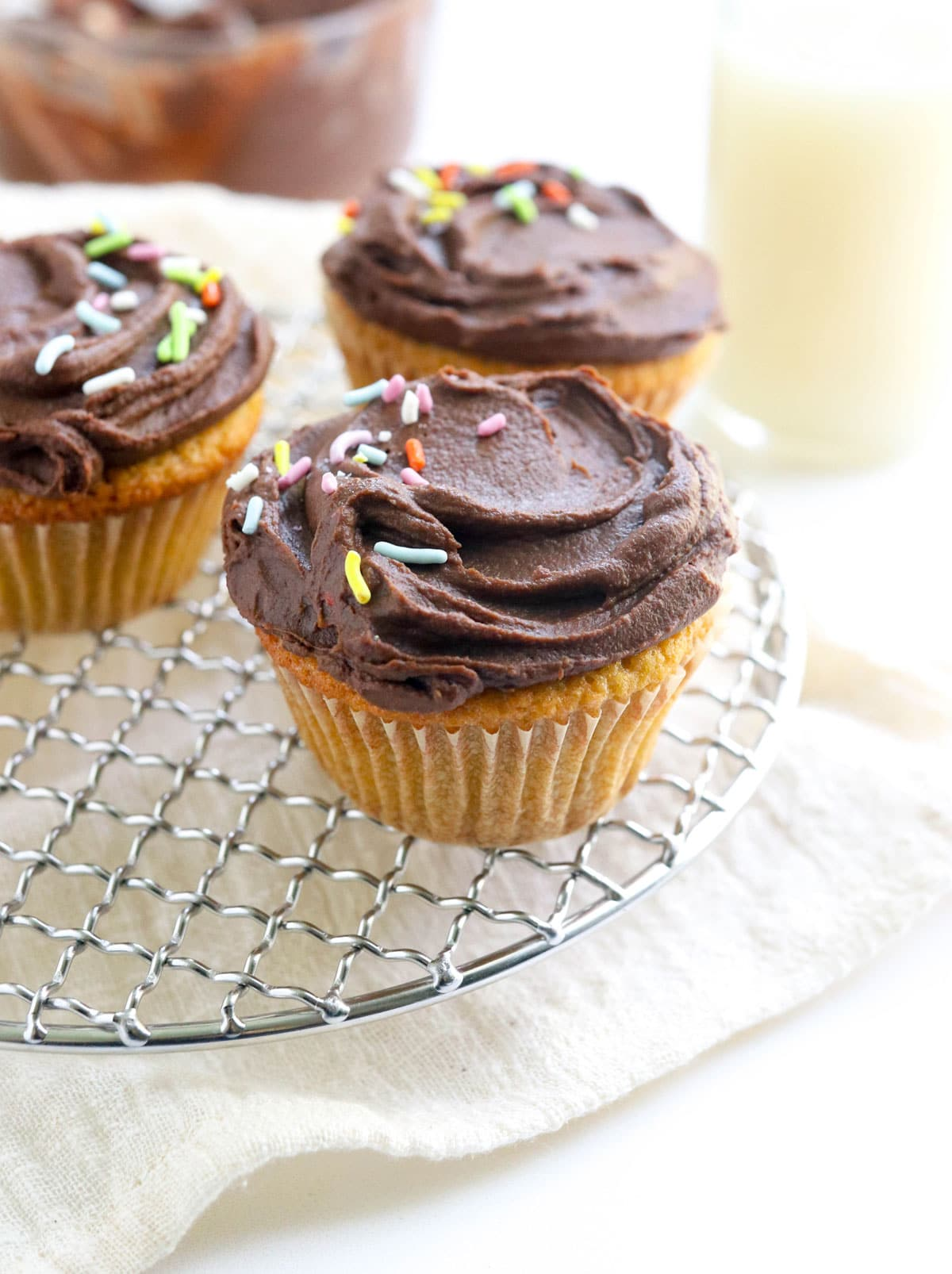 vanilla cupcakes with chocolate frosting and sprinkles
