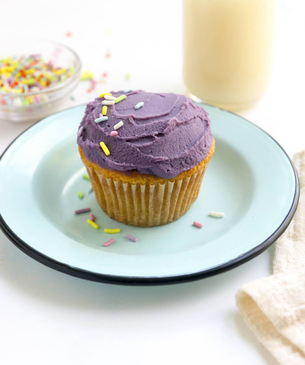 purple sweet potato frosting on cupcake on blue plate
