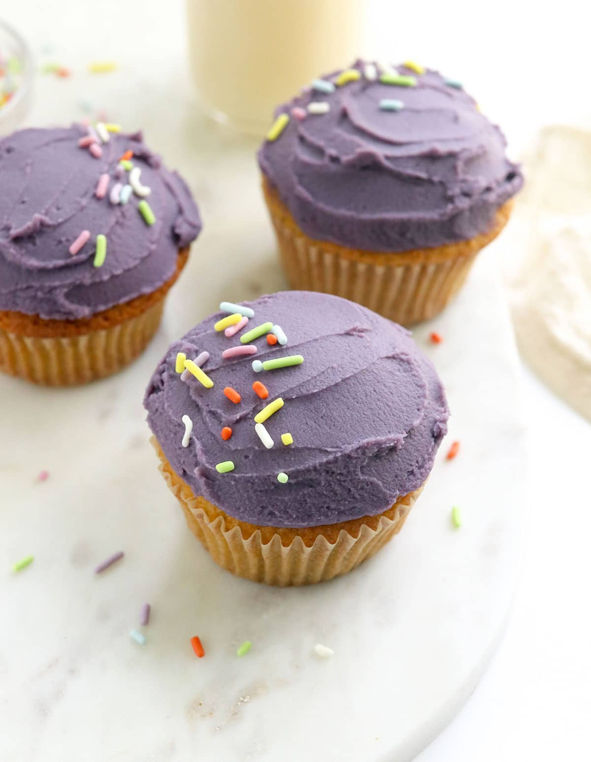 purple sweet potato frosting on cupcakes with sprinkles