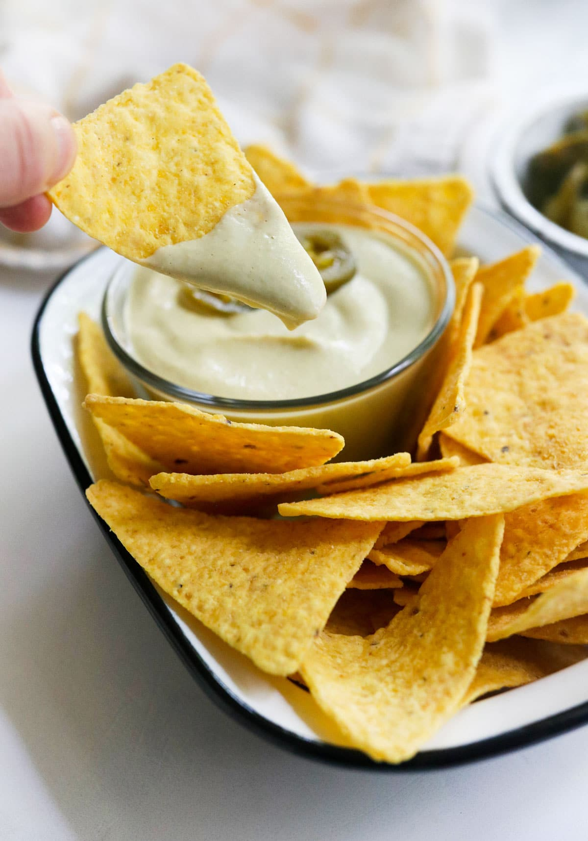 chip covered in nacho cheese sauce
