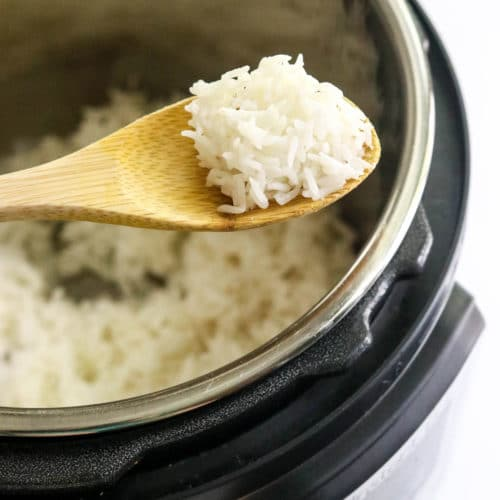 white rice on spoon over Instant Pot