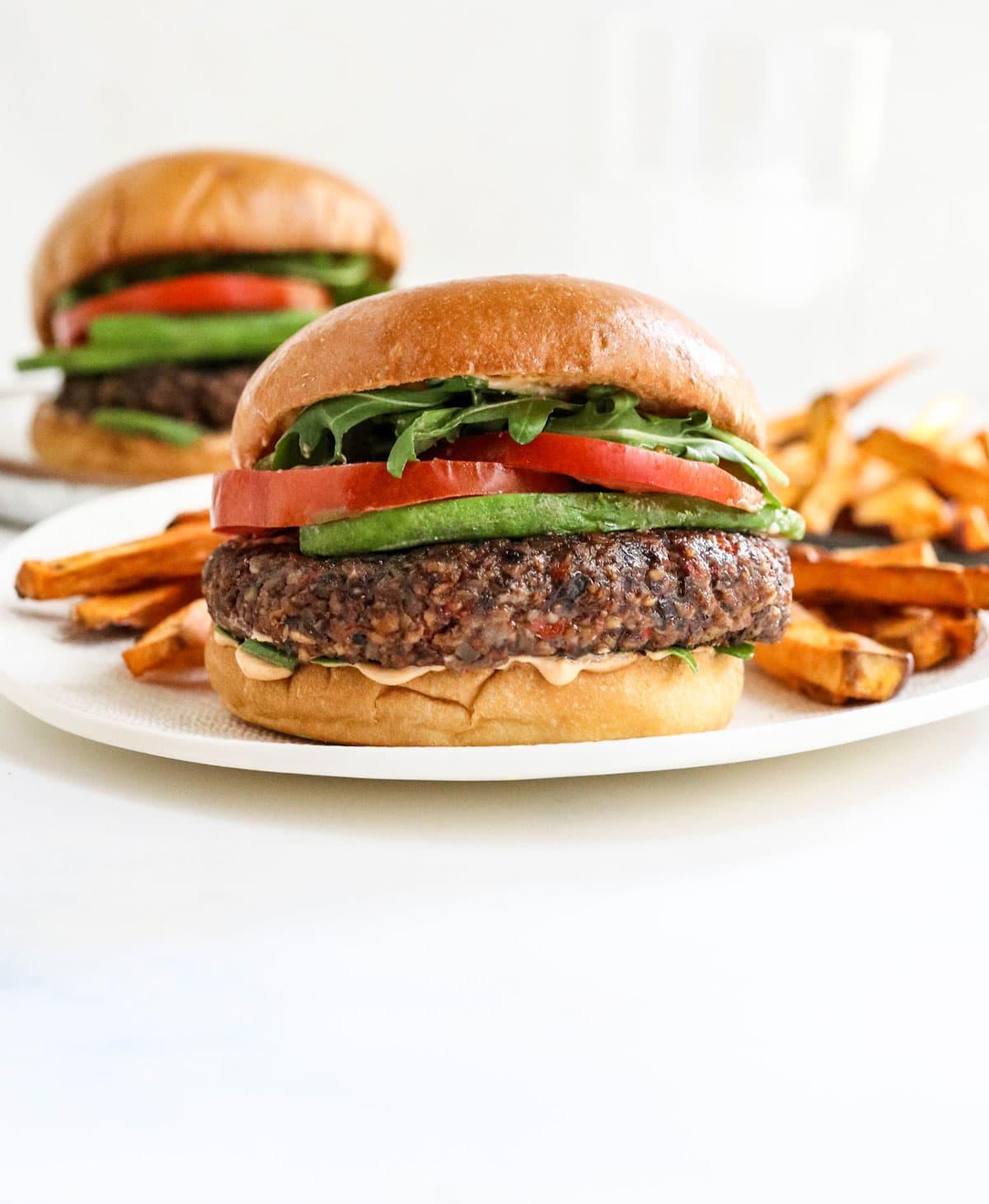 veggie burgers on white plates