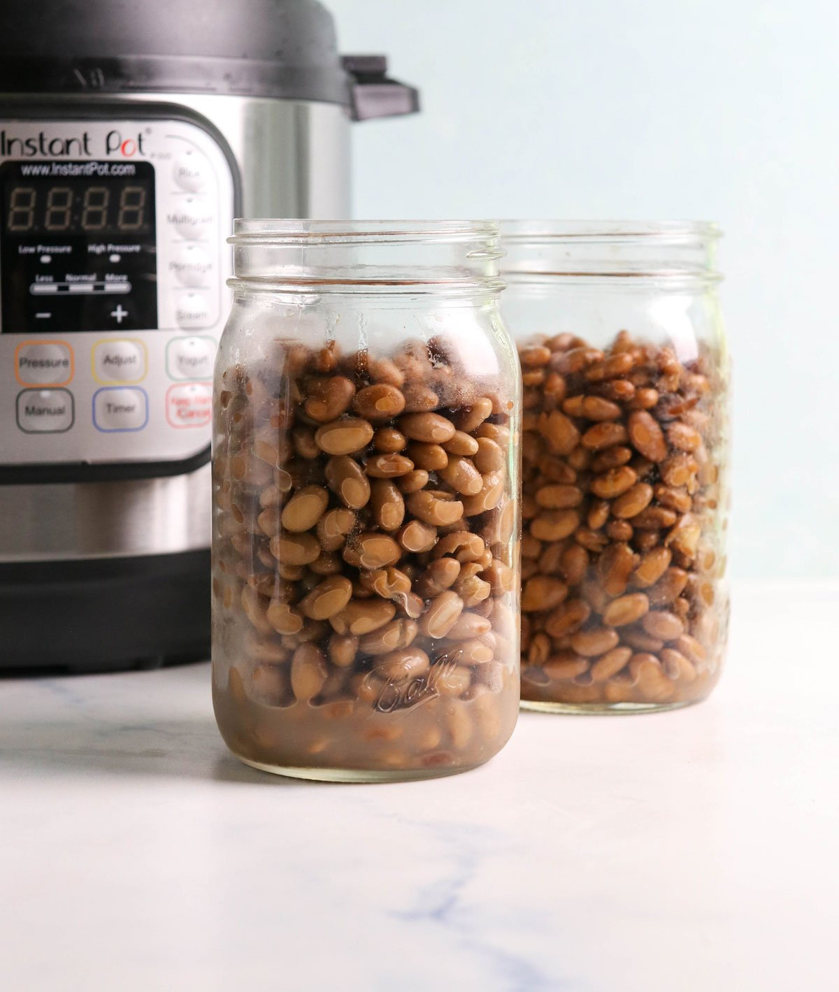 two glass jars of beans by Instant Pot
