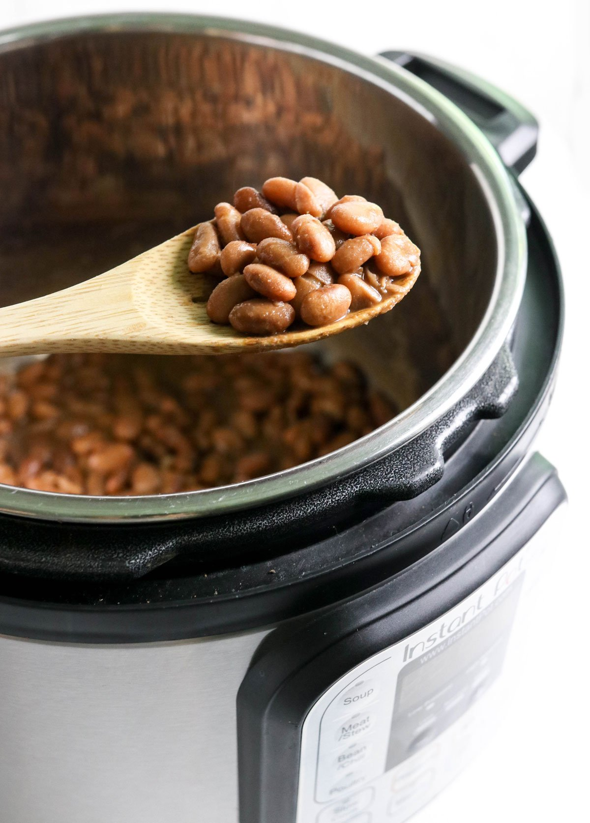 spoon full of beans over the Instant Pot