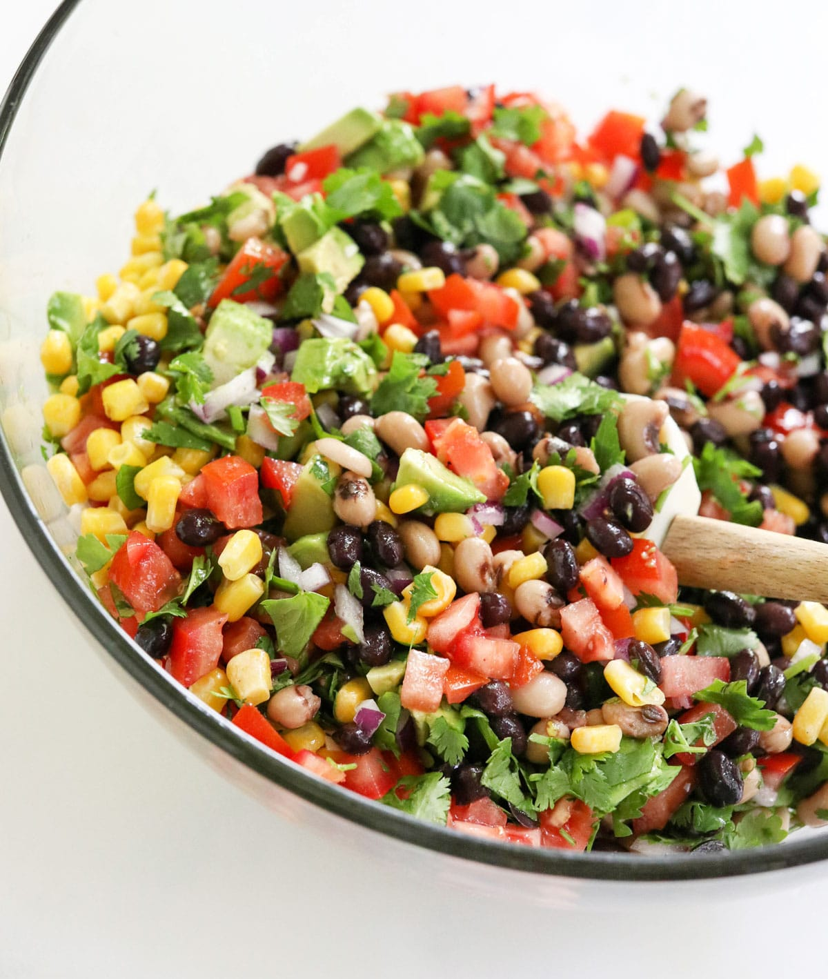 chopped veggies and beans in glass bowl