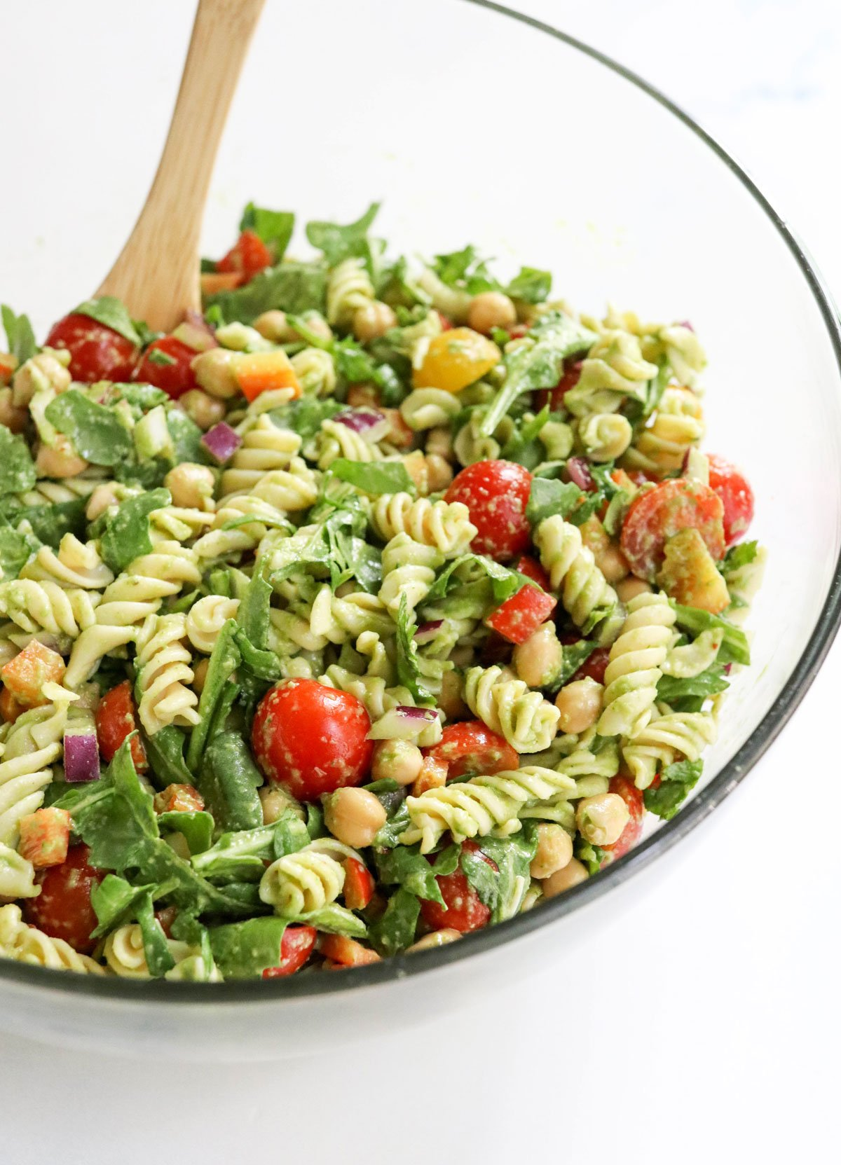pesto pasta salad mixed together in large bowl