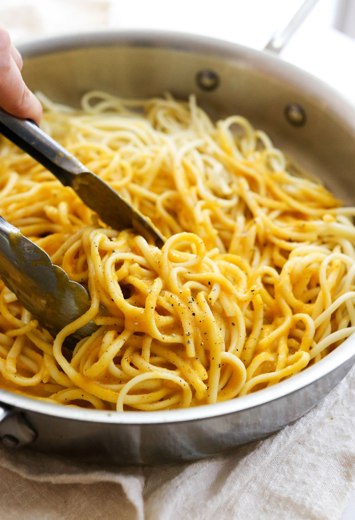 creamy butternut pasta tossed in pan