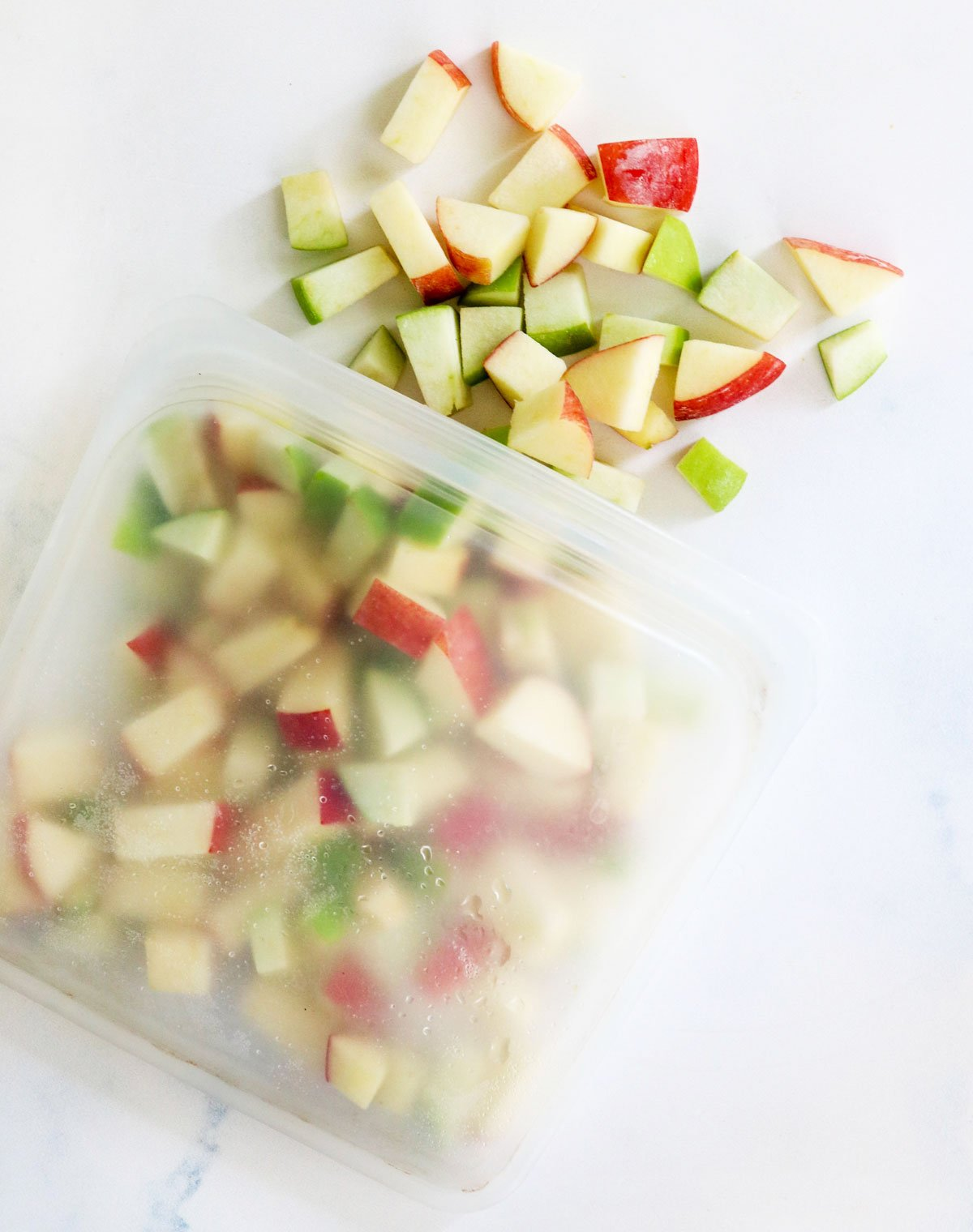 green and red frozen apples in bag