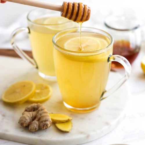 honey added to cup of ginger tea