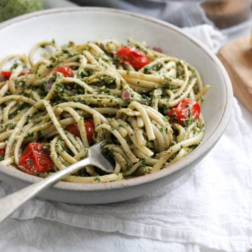 bowl of noodles tossed with kale pesto