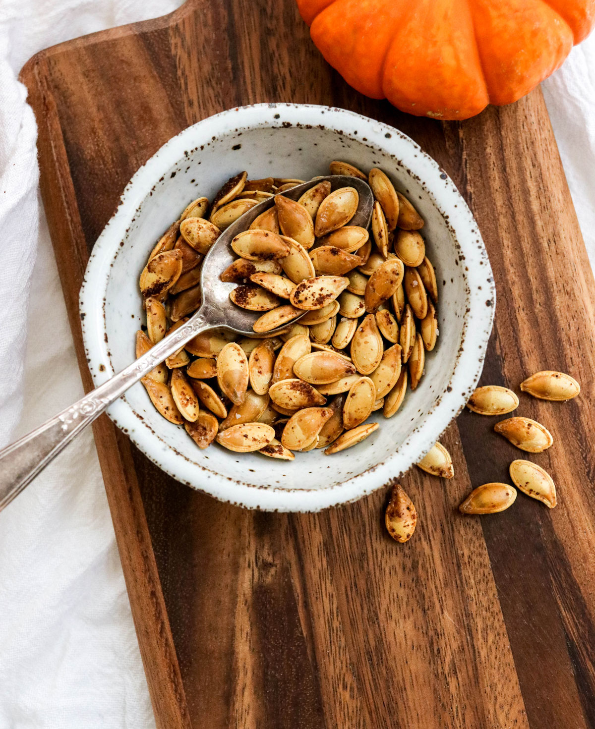 roasted pumpkin seeds in a white bowl
