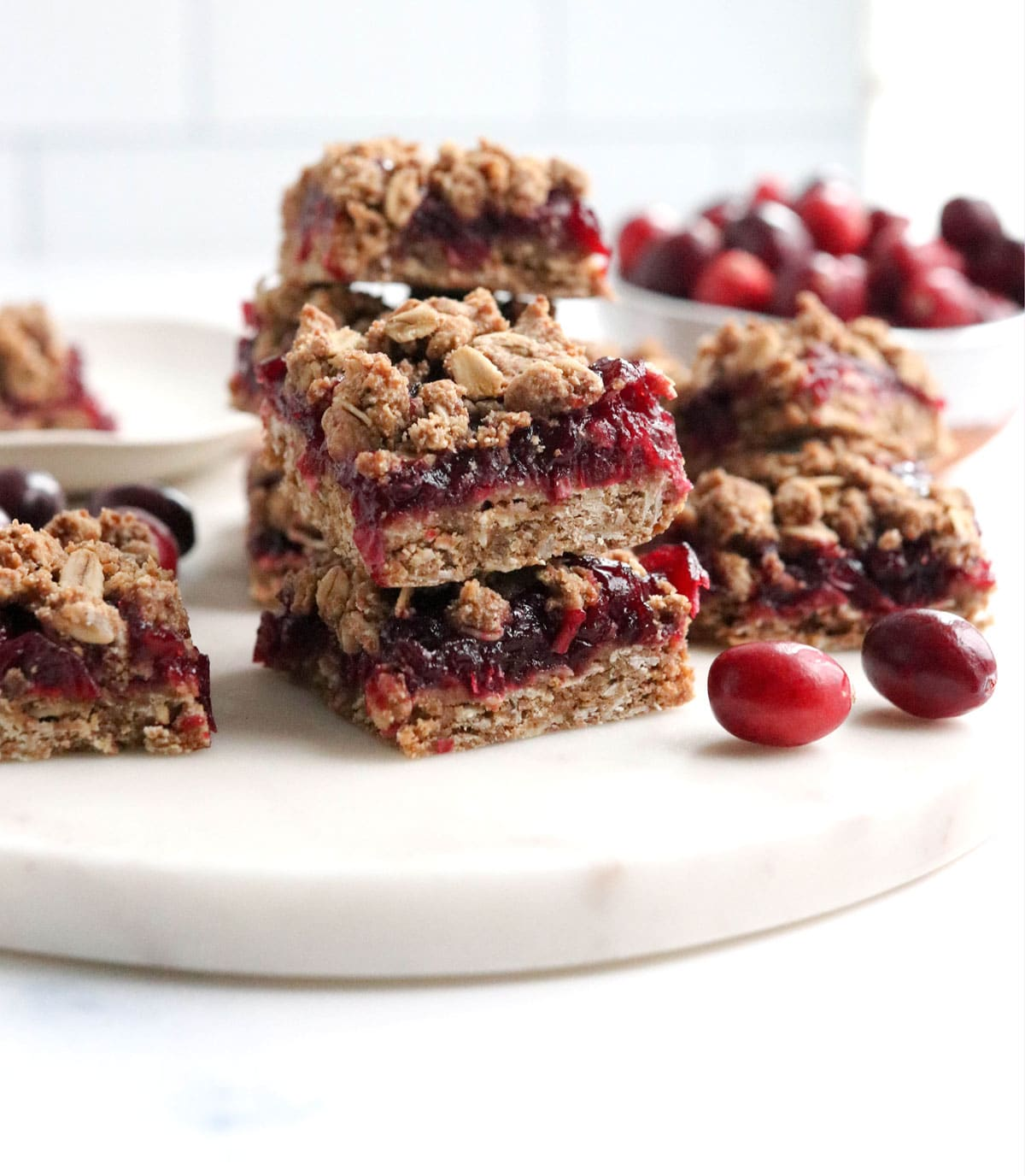 cranberry bars stacked on marble board