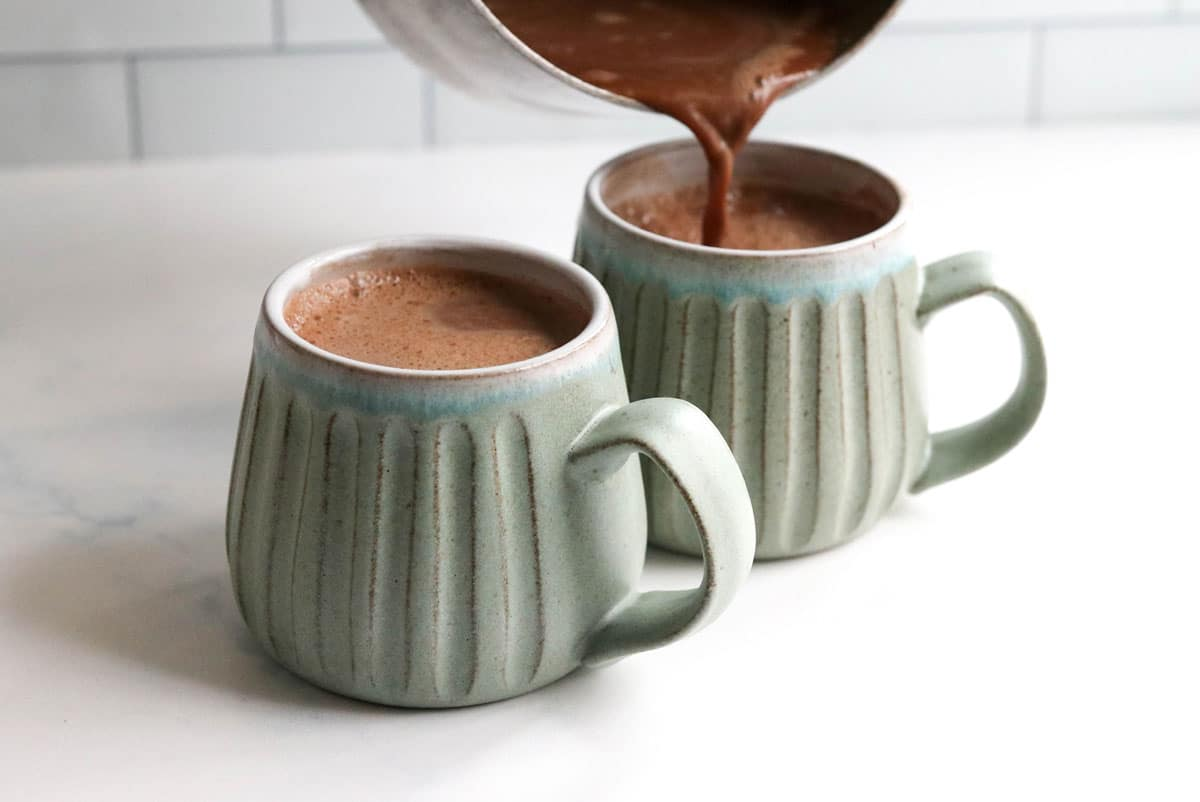 hot chocolate poured into mugs