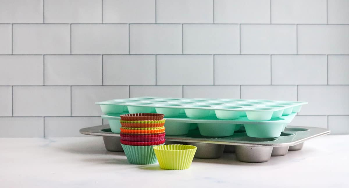 muffin pans and liners on counter