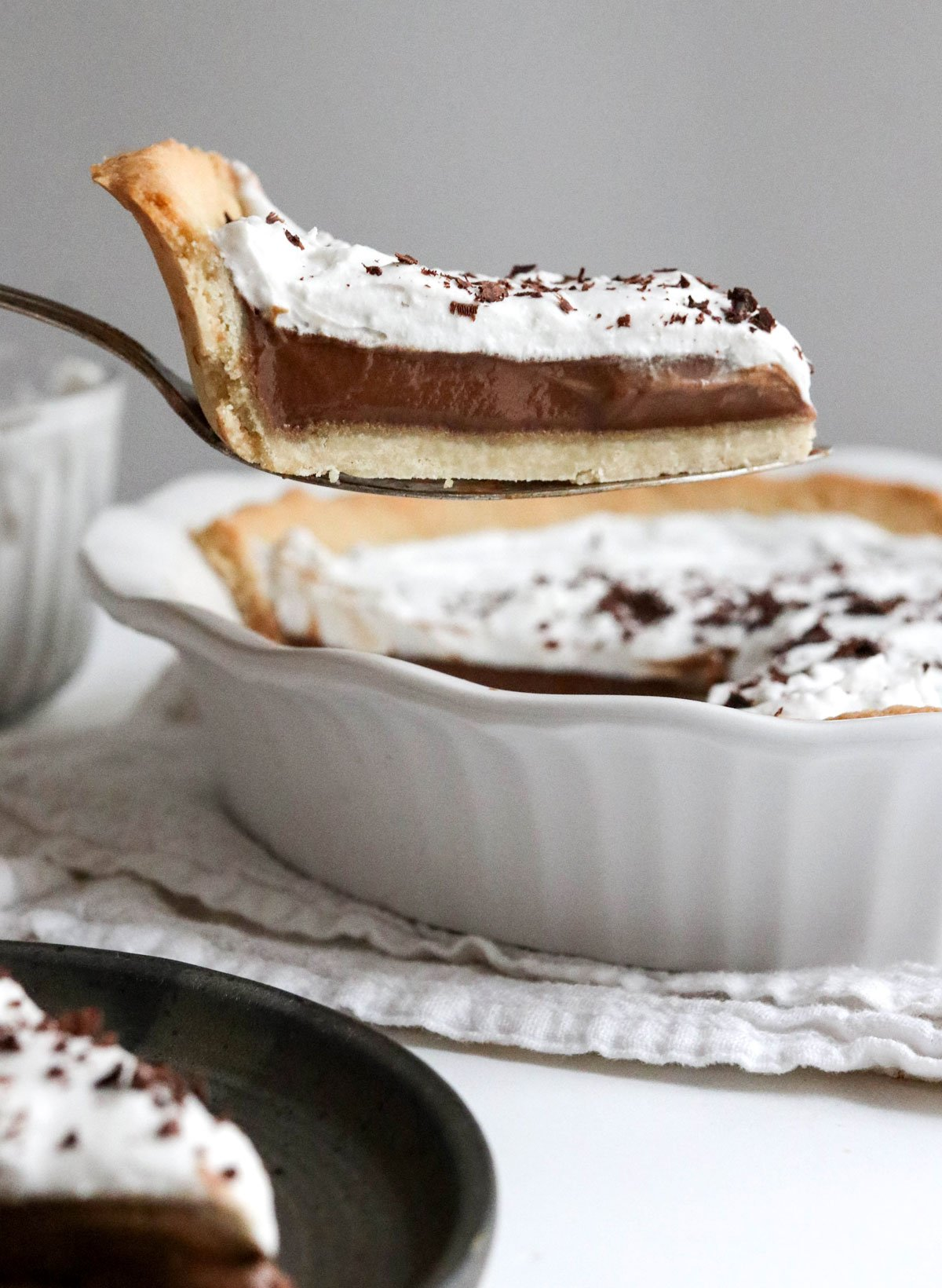 slice of pie with almond flour pie crust lifted