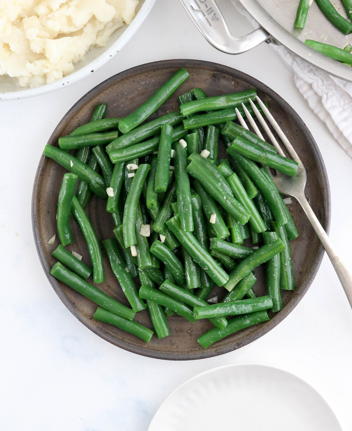 sauteed green beans on plate overhead