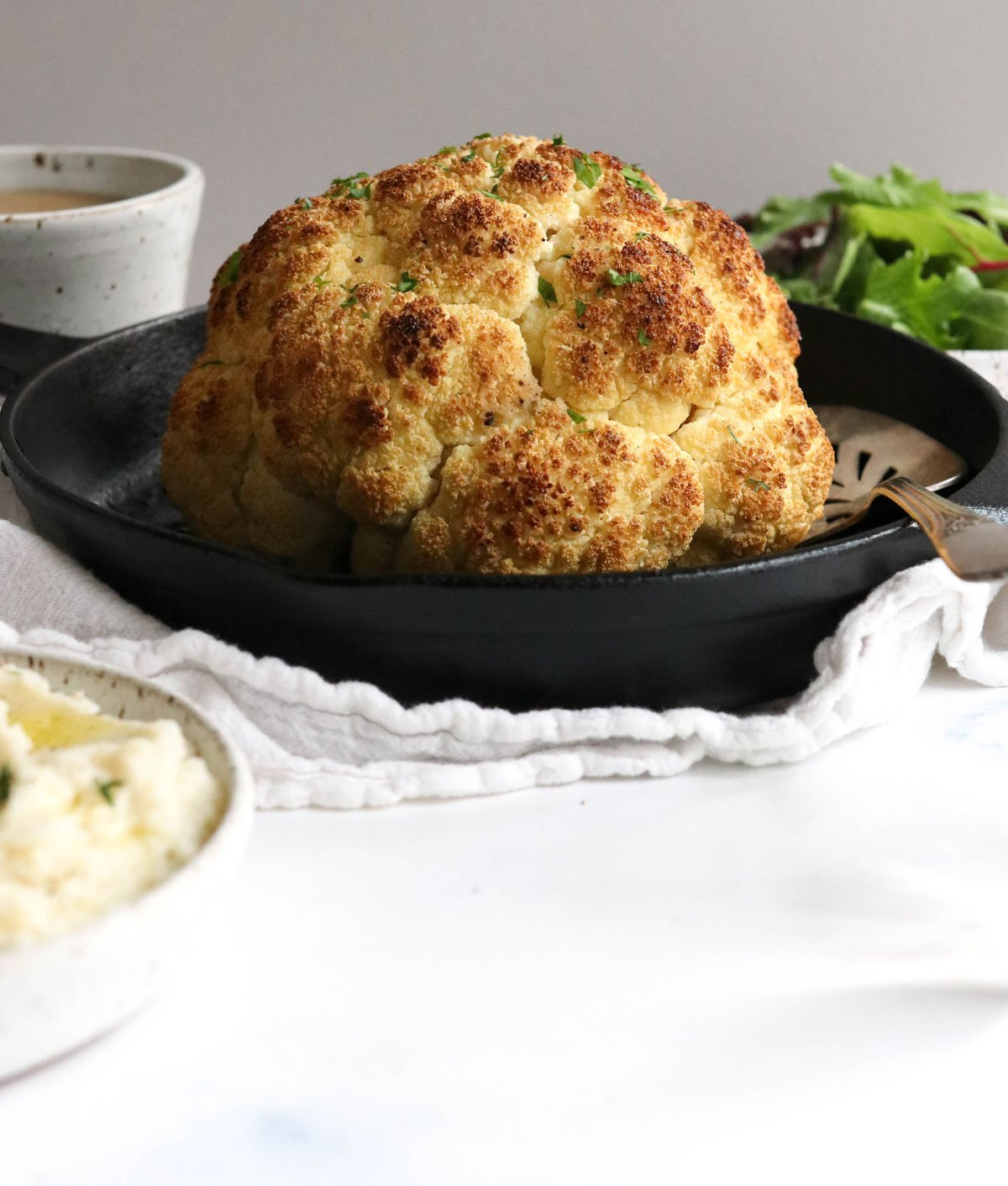 whole roasted cauliflower in pan