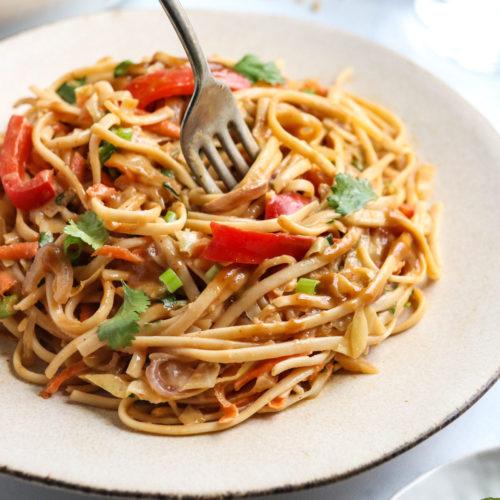 fork twirling peanut noodles