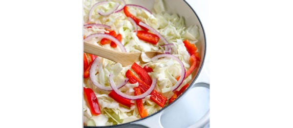cabbage peppers and onions in pan
